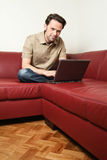 Man doing some laptop worh at home Royalty Free Stock Photo