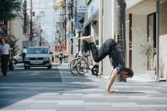 KYOTO, JAPAN, SEPTEMBER 14, 2017: Man doing some yoga excersises in the middle of a street in Kyoto stock images