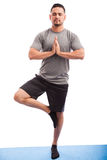 Man doing some yoga in a studio Royalty Free Stock Image