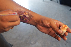 Man doing special effect wound Makeup in hand Royalty Free Stock Photos