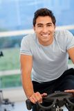 Man doing spinning in a gym Royalty Free Stock Photography