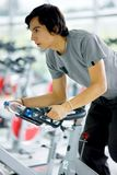 Man doing spinning in a gym Royalty Free Stock Images