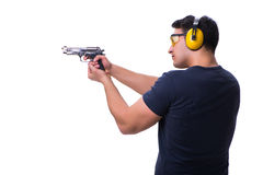 The man doing sport shooting from gun isolated on white Stock Photo