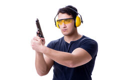 The man doing sport shooting from gun isolated on white Royalty Free Stock Photography
