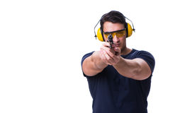 The man doing sport shooting from gun isolated on white Stock Image