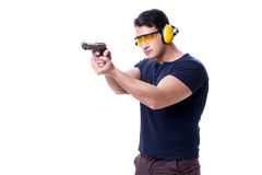 The man doing sport shooting from gun isolated on white Stock Photos