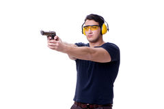The man doing sport shooting from gun isolated on white. Man doing sport shooting from gun isolated on white Stock Images