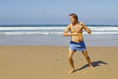Man doing sports at the beach Stock Images