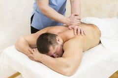 Man doing sports massage Stock Photography