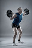 Man doing squats with barbell Royalty Free Stock Image