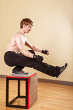 Man doing squats on one leg. Royalty Free Stock Image