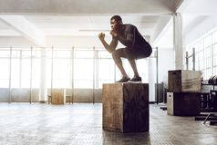 Crossfit guy training at the gym royalty free stock photography