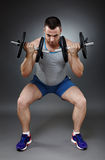 Man doing squats Royalty Free Stock Photography