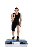 Man doing step exercise Stock Photo