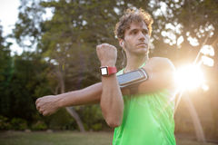 Man doing stretching exercise. In park Royalty Free Stock Photos