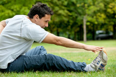 Man doing stretching exercises Stock Photography