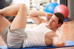 Man Doing Stretching Exercises Stock Images