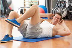Man Doing Stretching Exercises Stock Photos