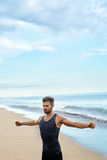 Man Doing Stretching Workout Exercises, Exercising At Beach. Fitness Royalty Free Stock Image