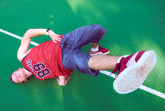 Man doing stunt trick on basketball field Stock Photography