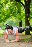 Man doing suspension trainer sling sport Stock Photography