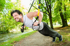 Man doing suspension trainer sling sport Royalty Free Stock Photos