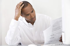 Man Doing Taxes Royalty Free Stock Images