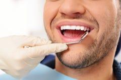 Man doing teeth checkup Royalty Free Stock Photo