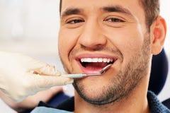 Man doing teeth checkup Stock Photography