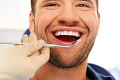 Man doing teeth checkup Stock Images