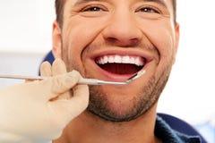 Man doing teeth checkup Stock Images