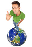 Man doing thumb up on top of a globe Stock Photography