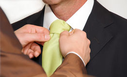 Man doing tie Royalty Free Stock Photos