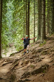 Man doing trail running in the forest Royalty Free Stock Photography