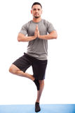 Man doing a tree yoga pose Royalty Free Stock Photos