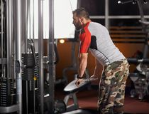 Man doing triceps workout Stock Photos