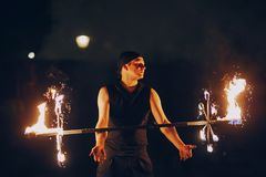 Fireshow in awedding. Man doing tricks with fire Royalty Free Stock Photo