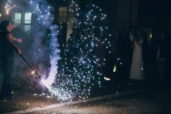 Fireshow in awedding. Man doing tricks with fire Royalty Free Stock Images
