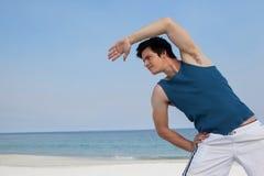 Man doing warm up on beach. Muscular man doing warm up on beach Stock Photos
