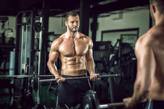Man doing weight lifting in gym Royalty Free Stock Photos