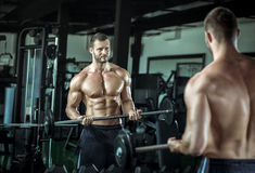 Man doing weight lifting in gym Royalty Free Stock Image