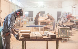 Man doing woodwork in carpentry Royalty Free Stock Photos