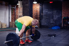 Man doing workout in a gym royalty free stock images