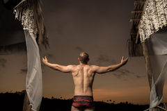 Man doing workout at sunset Royalty Free Stock Images