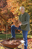 Man doing yard work in autumn Stock Photography