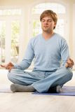 Man doing yoga Stock Photography