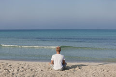 Man doing yoga on the beach Sports Landscape Royalty Free Stock Photography