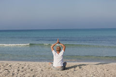 Man doing yoga on the beach Sports Landscape Royalty Free Stock Photos