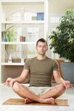 Man doing yoga exercise Stock Photography