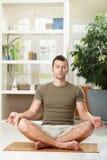 Man doing yoga exercise stock photography